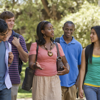 College Teacher Walking  with Students  on Campus