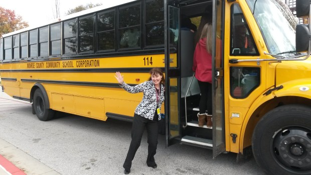 Fiona with the school bus at a school she worked with